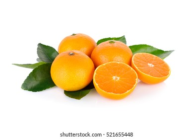 whole and cut ripe orange with leaf on white background