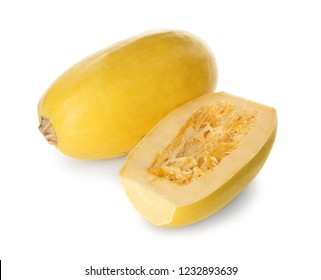 Whole and cut spaghetti squashes on white background