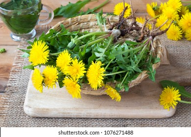 Whole dandelion plants with roots in a wicker basket