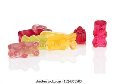 Lot of whole disordered gummy bear isolated on white background