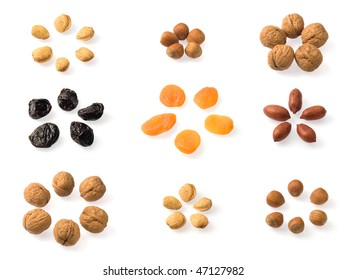 Whole dried fruits collection over white. Includes almonds, hazelnuts, pecans, walnuts, prunes and dried apricots. Includes almonds, hazelnuts, pecans, walnuts, prunes and dried apricots.