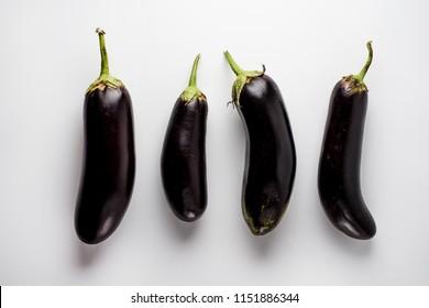 Whole eggplants on white background