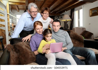 Whole family around a laptop