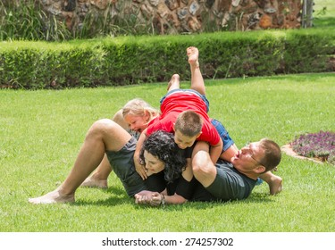 The whole family playing on the lawn on a lovely summer's day.