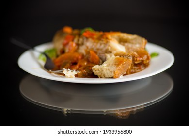 whole fish hake stewed with carrots, beets, peppers and other vegetables.