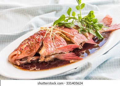 Whole fish steamed and served with sauce