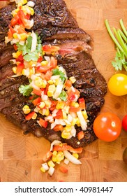 Whole flank steak served with corn salsa