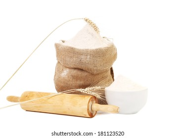 Whole flour in bag with wheat ears. Isolated on a white background.