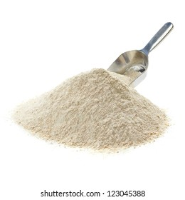 Whole flour pile with scoop on white background