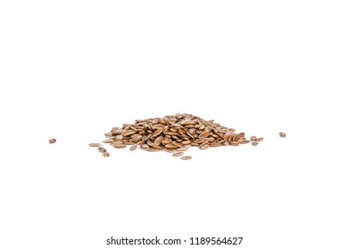 Lot of whole fresh brown flaxseeds isolated on white background