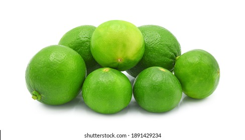 Whole fresh green lime isolated on white background.