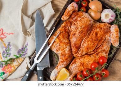 Whole fresh raw spatchcock chicken piri piri