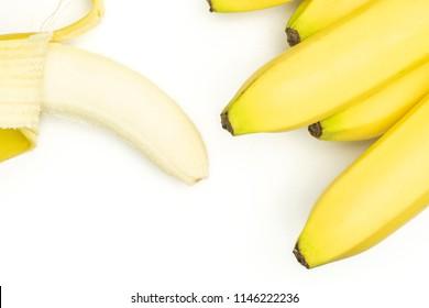 Lot of whole fresh yellow banana and one opened flatlay isolated on white background