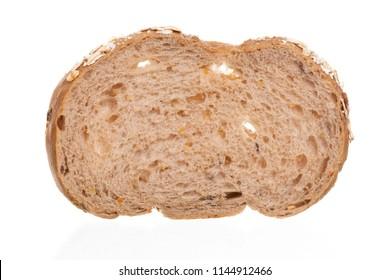 Whole grain bread Cut over white background, closeup