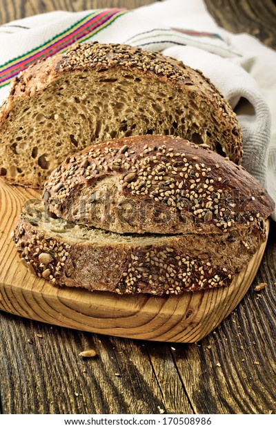 Whole grain bread on on wooden background
