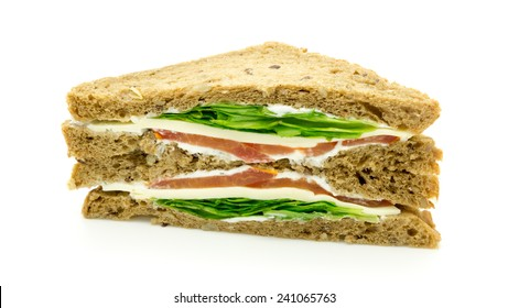 Whole grain bread Sandwich with cheese , tomato and salad. Isolated on white background.