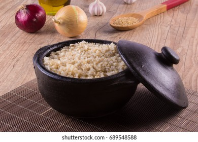 Whole grain brown rice cooked into a pan. Integral