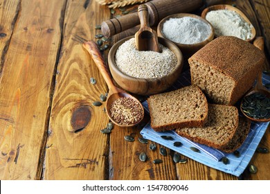 Whole grain diet bread with amaranth on a brown background
