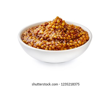 Whole grain mustard. French mustard in white bowl isolated.