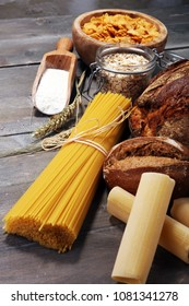 whole grain products with complex carbohydrates on rustic background