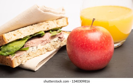 whole grain sandwich and Napkin.  Sliced bread with Spinach, Steak and Stilton wrapped in a cotton napkin.  Healthy lunch with crusts. seeds and bread sandwich look delicious and ready to eat & drink