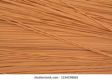 whole grain of spaghetti for background and texuture