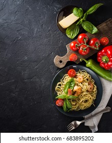 whole grain spaghetti pasta with shrimps, top view, copy space