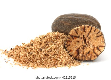 Whole and grated nutmeg closeup on white background
