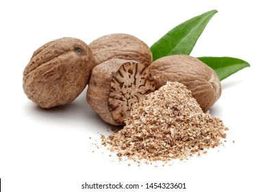 Whole and grated nutmeg with leaves isolated on white background