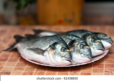 Whole grilled Dorada fish with vegetables