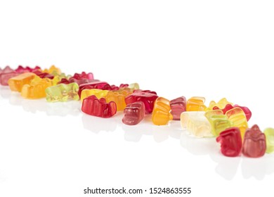 Lot of whole gummy bear in diagonal isolated on white background