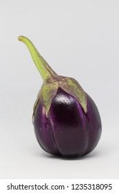 Whole and half aubergine on white background isolated.