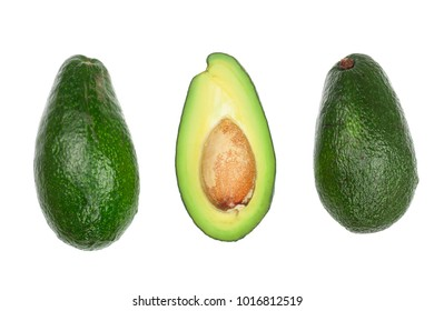 whole and half avocado isolated on white background close-up. Top view. Flat lay pattern