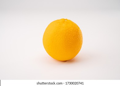 Whole and half cut  orange on white background