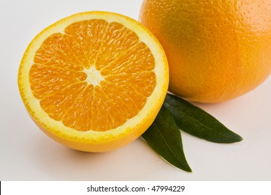 A Whole and a Half Orange Isolated on White with Leaves Horizontal