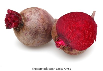 Whole and half red beet roots isolated on white background