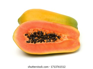 Whole and half ripe papaya fruit isolated on white background.