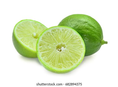 whole and half of seedless fresh green lime isolated on white background