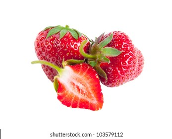 Whole and half strawberries isolated on white background