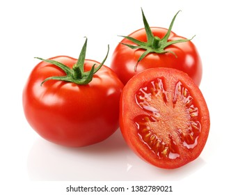 Whole and half tomatoes isolated on white background