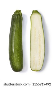 Whole and half of a zucchini isolated on white background.