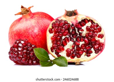 A whole and a half-cutted pomegranate with red seeds in the front