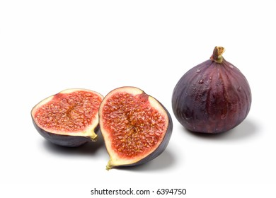 a whole and a halved fig isolated on white background