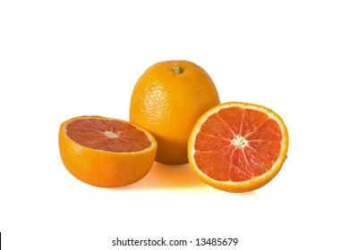"Whole and halved pink navel orange;"" cara cara orange"" against a white background"