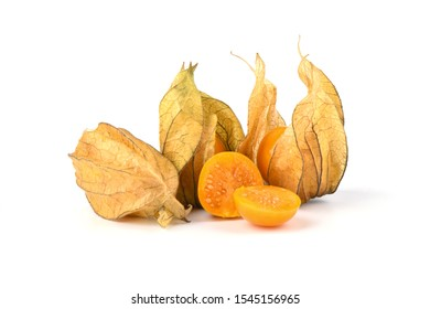 Whole and halves of ripe physalis berries isolated on a white background. Close up. Copy space.