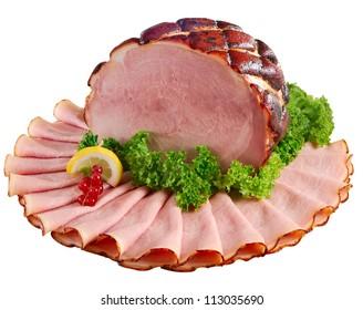 Whole ham honey-baked and orange glazed displayed with slices. Isolated on white.