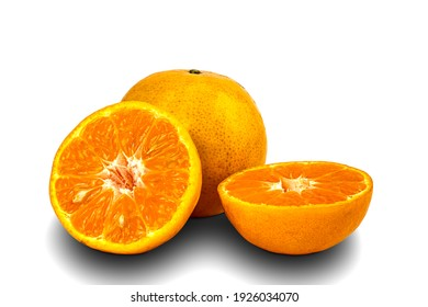 Whole and haves ripe oranges on white background with clipping path.