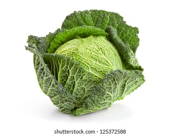 Whole head of savoy cabbage over white background