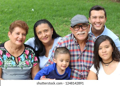 Whole Hispanic real looking family