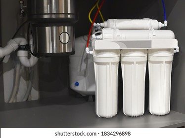 Whole house rainwater filter system. Osmosis deionization system. Water treatment Appliances, ultrafiltration background. Home water filtration system. Small sharpness, possible granularity